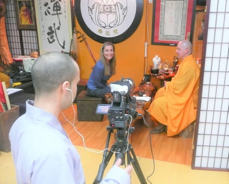 STACEY INTERVIEWING ABBOT SHI YAN FAN OF SHAOLIN TEMPLE LOS ANGELES FOR HER ARTICLE ABOUT HIM IN THE HUFFINGTON POST AND KUNG FU MAGAZINE'S E-ZINE.